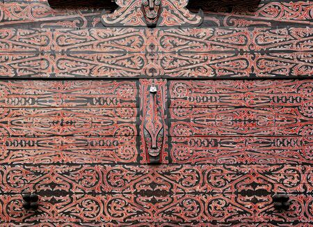 believes: Indonesia, Sumatra:detail of a wood typical painting and carved  decoration of an Indonesian house Stock Photo