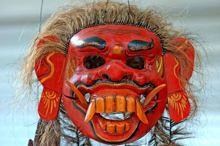 belive: Indonesia, Java: red painted mask of a demon, an indonesian typical handcraft