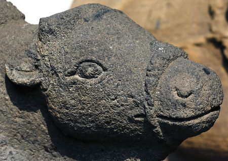 Indonesia, Java: stone statue representing a ox head; maybe Nando the vehicle of an indian god Stock Photo