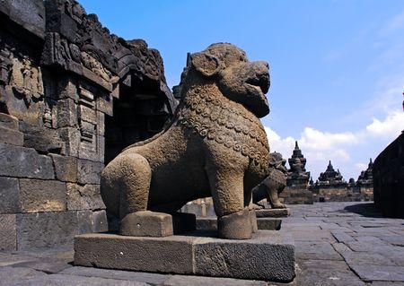 protectors: Indonesia, Java, Borobudur: the temple guardians; stone seated lions statues representing the guards and protectors of the temple Stock Photo