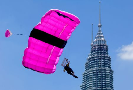thrilling: Malaysia Kuala Lumpur International exhibition of Tower Jump, blue sky and colorful parachute, twin tower Editorial