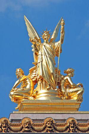timeless: France, paris: Statue of Opera Garnier, blue sky and a enormous golden leaf statue