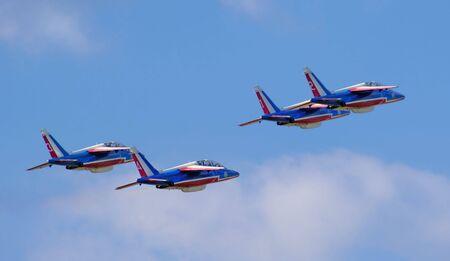 pontoise: France, Pontoise:  blue sky and the Patrouille de France during the flight