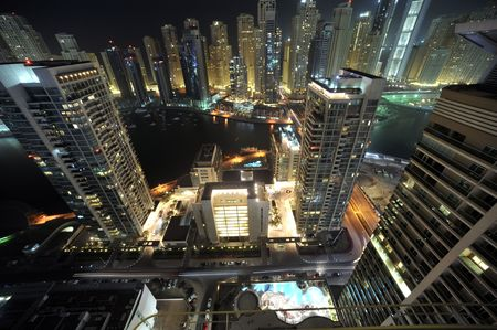 foreign trade: United Arab Emirates: Dubai skyline at night, an impressive view of the new city in the area of dubai marina. the second largest manmade marina in the world. a residental district Stock Photo