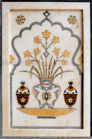 mahal: india, agra: taj mahal; marble decoration; vase with flowers. a stylish and symetrical design for this outdoor decoration of the taj mahal