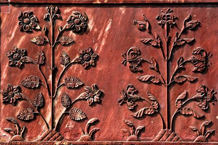 17th century: India, Agra: Taj Mahal; detail of a red stone wall of the mosques outdoor wall; stone carved flowers
