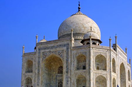 tribute: india, agra: blue sky and a perspective  of one of the seven wonders in the world ; the taj mahal; monument constructed at the 17th century by the fifth mughal emperor Shah Jahan , a love tribute to his wife  Stock Photo