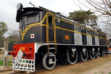 oldest: India : one of the oldest running locomotive in the world; this is a steam powered machine; a railway machine Stock Photo