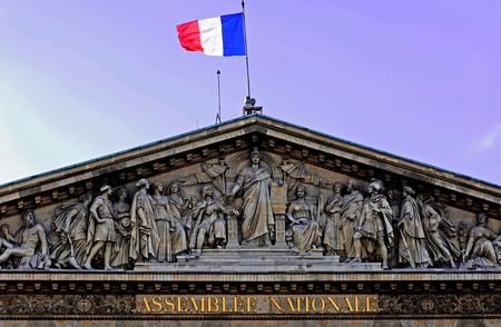pediment: France, Paris: national assembly; blue sky and the french flag. an ancient architecture; monument of pais; with a carved pediment