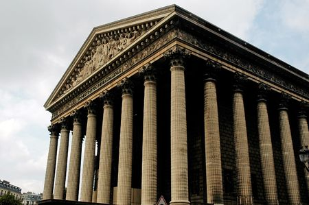 pediment: France, Paris: Church of  La Madeleine; blue sky and a  romaine architecture for this ancient building with a colomns line and a nice carved pediment