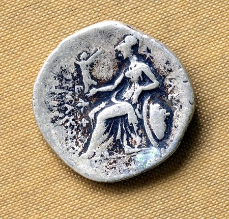 magistrates: Old roman coin; romain coins are latter than those from grece or asie minor; the coin generally represents a head on one face and in the other symbolic images with political messages. the coin can be in bronze, silver and eventually in gold; this coin see Stock Photo