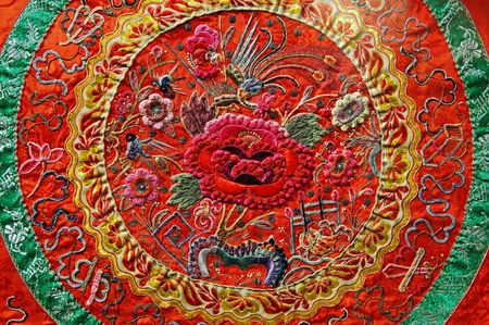 ancient tradition: Chinese art: silk ancient  embroidery with typical chinese motif Stock Photo