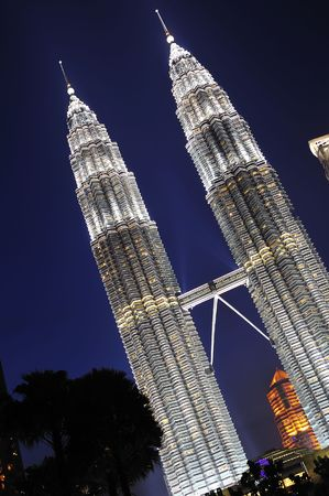 malaysia kuala lumpur the twin towers of petronas at the city center illuminated at the beginning of the night