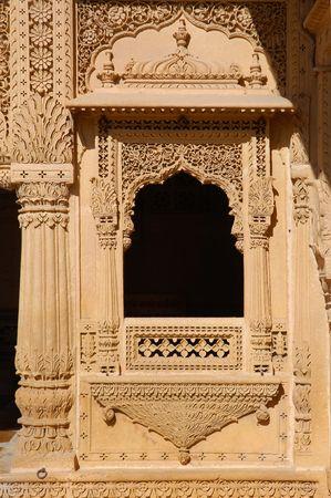 India, Rajasthan, Jaisalmer: Jain Temple; architectural detail; carved framed window photo
