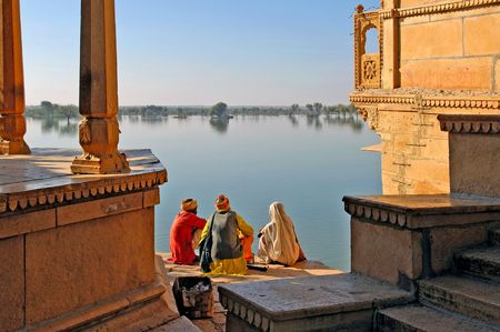 India, Rajasthan, Jaisalmer: the lake near Jaisalmer; indian women looking to the lake in the end of the afternoon