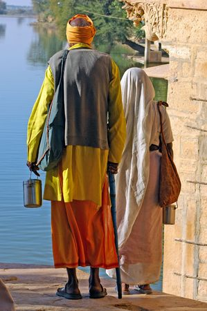 India, Rajasthan, Jaisalmer: old couple; dignity of an old indian couple walking on the street near the lake after the temples visit photo