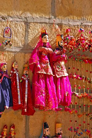 puppet show: India, Rajasthan, Jaisalmer: marionette; traditional wooden figures representing women in a traditional red sari