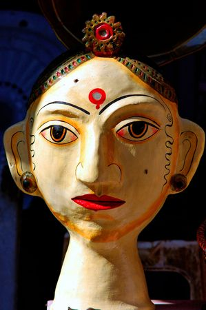 India, Rajasthan, Jaisalmer: marionette; traditional wooden figures representing women in a traditional red sari photo