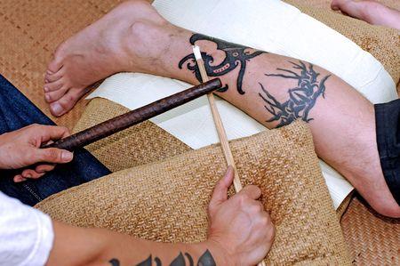 borneo: Malaysia, Sarawak: traditional hammer tattoo; an ancient technique