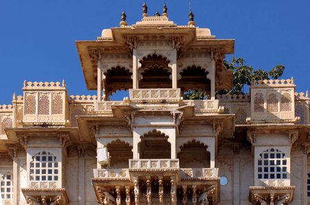 India; udaipur; city palace; the city palace sheltes the pratap museum; a fantastic ancient red stone architecture for this famous palace