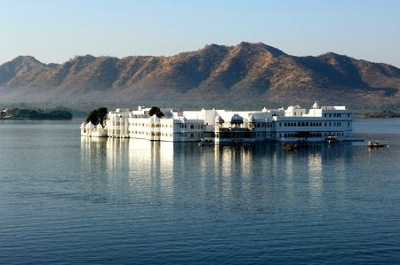 India, udaipur: Lake palace; view of the famous palace today converted in heritage hotel ; the palace is situated in the heart of the lake pichola; a construction in white marble