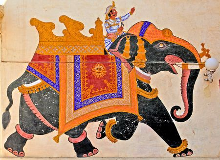 rajasthan: India, Udaipur: fresco on a wall; colorful indian men riding an elephant  in traditional suit ; antique paintings of mehwar Stock Photo