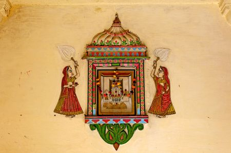 representations: India, Udaipur: fresco on a wall; colorful indian architecture and two women in  traditional dress ; antique paintings of mehwar