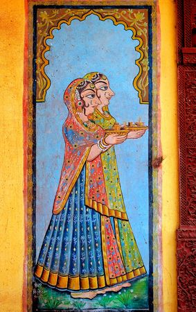 saree: India, Jaisalmer: painting on the wall of a small palace; blue background and two women dressed with the typical saree Stock Photo