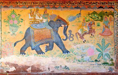 ganesh: India, Jaisalmer: schilderen op de muur van een klein paleis; rode achtergrond en een olifant en zijn berijder