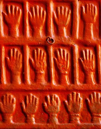 cremated: India, Jodhpur: Hands on the wall in Maradja palace of Jodhpur, the number of the hands corresponds to the number of the wifes obligatory cremated when the prince and husband dieded