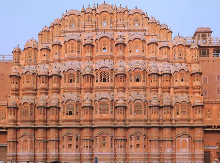 India Jaipur; hawa mahal the palace of winds; situated in the heart of the city this palace is the major attraction for tourist in rajasthan; architecture in pink sandstone with 953 windows allowing  the circulation of the breeze; this construction makes  Stock Photo
