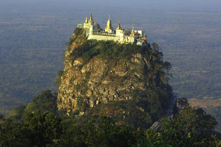 myanmar: Myanmar, mount popa or popa hill; popa hill is a volcano probably extinct situated in central myanmar; a buddhist monastery is located on the summit; the pik of mount popa is known as taung kalat ; this is a view of the taung kalat from the mont popa