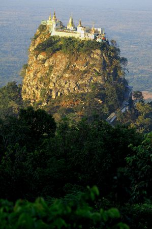 Myanmar, mount popa or popa hill; popa hill is a volcano probably extinct situated in central myanmar; a buddhist monastery is located on the summit; the pik of mount popa is known as taung kalat ; this is a view of the taung kalat from the mont popa Stock Photo - 2870881