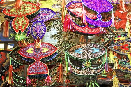 flying kites: Malaysia, Kuala Lumpur: colorful asian paper kites; kites and kite fighting are very famous in this region of the world