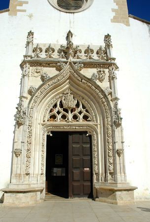 processions: Portugal, Tomar: Sao Joao Baptista church situated in the main square of the city; the church was constructed between the 15th and 16th century; architectural detail of the main entrance  Stock Photo