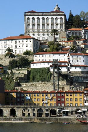 Portugal, Porto: Ribeira district;   view of the ancient city with is main river , the douro; many restaurants are located in this area;  view of the typical colored facades of the portuguese architecture ; in front of these houses the visitor can discove photo
