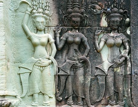 12th century: Angkor Wat is probably the biggest and the most famous temple in the world constructed in the 12th century by the king Suryavarman II. Near the doors numerous figures of elegant young women are sculpted. They are the famous apsaras or devatas, celestial d