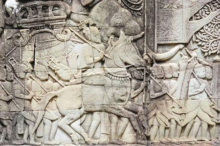 historians: Bayon la costruzione inizi� probabilmente arround 1200 dC durante il regno di Jayavarman VII a Jayavarman VIII. Storici dell'arte ha ritenuto che questo tempio � uno dei pi� enigmatici costruzione religiosa nel mondo. qui un esempio dei bassorilievi