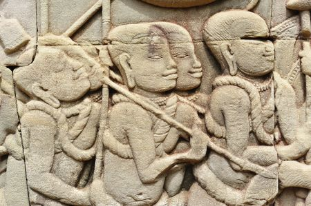 cambodia sculpture: The Bayon was constructed during the reign of Jayavarman VII and Jayavarman VIII (13th century). The temple is one of the most enigmatic religious constructions in the world. Here a representation of  the infantry