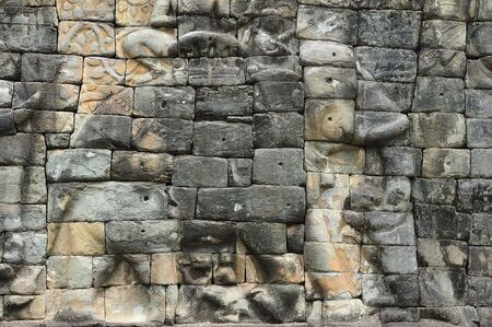 reigns:  The elephant terrace constructed during the reigns of Jayavarman VII and Jayavarman VIII (12th-13th centuries) overlooking the royal square is supported by 300 meters of walls of foundation; these walls are carved with elephants, garudas and lion headed  Stock Photo