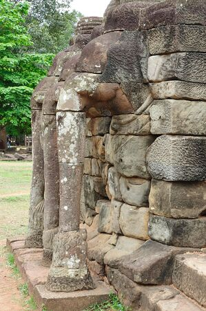 reigns: The elephant terrace in the style of bayon date from the 12th century with additions in  late 13th century during the reigns of Jayavarman VII and Jayavarman VIII ; this terrace looking out to the royal square is supported by  the 300 meters of walls of   Stock Photo