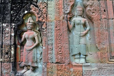 12th century: Cambodia; Angkor; The Preah Khan temple was constructed by the king Jayavarman VII (12th century); Probably a Buddhist university decorated with religious and mythological figures as the seated wise men, apsaras and guardians. The walls are strangle by th Stock Photo