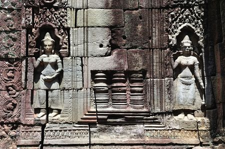 consecrated: The Ta Som is Khmer Buddhist temple consecrated to the memory of Jayavarmans VII father. A view of the carved walls with two small divinities or apsaras