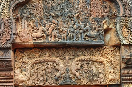 pediment: In Cambodia, in Angkor the 10th century temple of Banteay Srey was dedicated to the god Siva. The temple is known as �the jewel of the khmer art�. Here a elaborated carved pediment