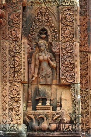 """apsara: In Cambodia, in Angkor the 10th century temple of Banteay Srey was dedicated to the god Siva. The temple is known as """"the jewel of the khmer art"""". Here a carved wall with an apsara"""