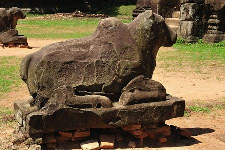 """nandi: In Cambodia in the ancient city of Roulos the Hindu temple of Preah Ko or"""" The sacred bull"""" was built in the 9th century by the king Indravarman. View of the statue of the bull Nandi Stock Photo"""