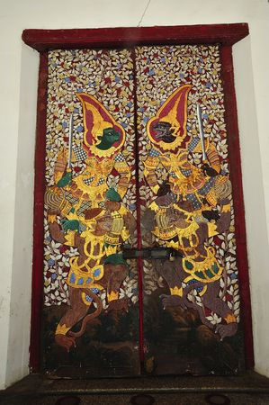 In Thailand, in Bangkok, the wat Suthat Thepwararam is a royal temple from the 19th century; the temple is remarkable for its ancient murals and its collection of Buddha images; view of a painting door  photo