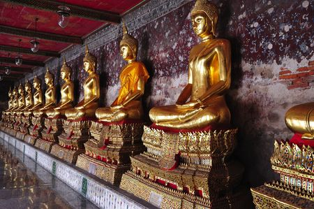 In Thailand, in Bangkok, the wat Suthat Thepwararam is a royal temple from the 19th century; the temple is remarkable for its ancient murals and its collection of Buddha images photo