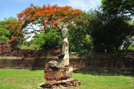 In Thailand the city of Ayutthaya was founded in 1350 today is an impressive archaeological park; here a view of a seated Buddha on the Phra Sri Sanphet photo
