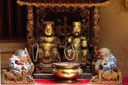 In Thailand the city of Ayutthaya was founded in 1350 today is an impressive archaeological park; here a view of an altar inside a Chinese temple on the back of Wat Phanan-Choeng photo